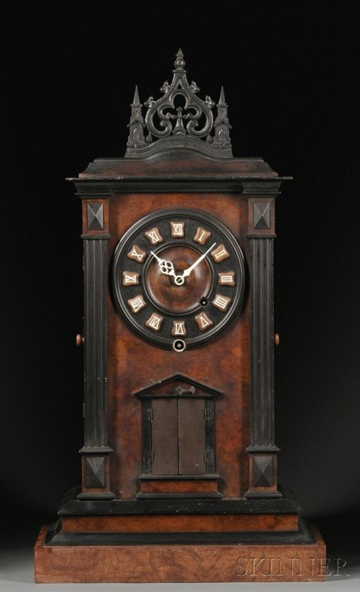 Antique clock... generally  classical, but with a Gothic touch.  (Possibly a transition between styles)