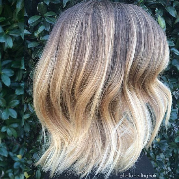 BLONDE LOB WITH DARK ROOTS This hairstyle is so breath-taking! It's modern, young and will cut down your blow-drying and styling time. To replicate this voluminous style, curl pieces of hair with a 2″ curling iron, and then use a flat iron to straighten the ends.