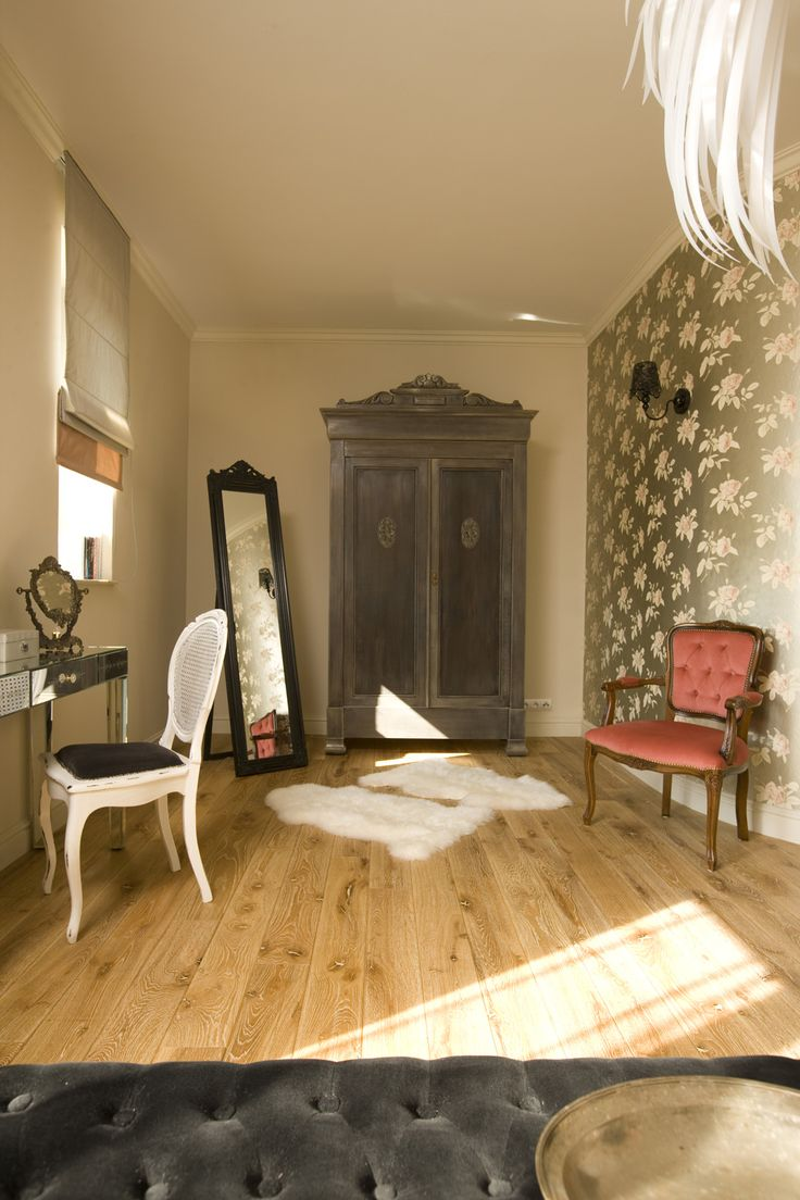 romantic bedroom with antique wardrobe, floral wallpaper and black carved frame mirror, cole and son wallpaper, pink stylish armchair, pastel bedroom