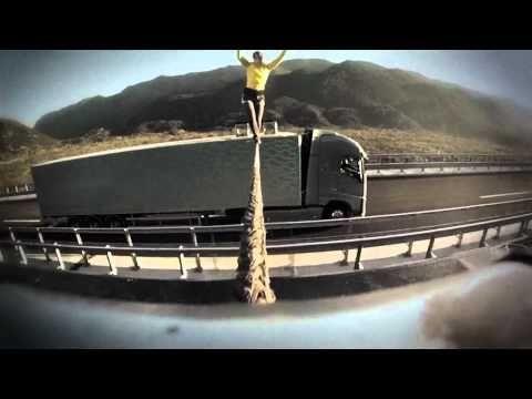 http://www.lifeslittlemysteries.com/2797-slackline-volvo-truck-stunt.html