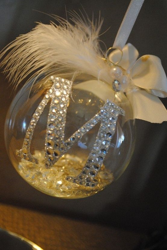 DIY- Monogrammed Ornament. Just a clear glass ornament with a Letter sticker, some feathers, glitter for the inside, and a ribbon to hang :)good to do 1 each for the kids