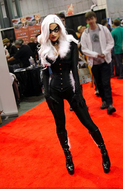 beautilation: Black Cat cosplay at this years Comic Con. I worked pretty hard on the entire costume but I think the toughest part was wearing that 18 inch corset all day. No, the hardest part was not being able to eat more than a bite of a big pretzel all day because digesting does not happen in an 18 inch corset.