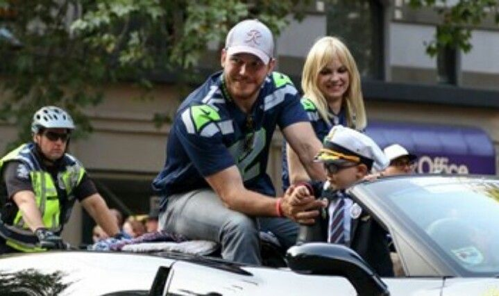 Actor Chris Pratt and wife Anna Faris and their son Jack were this year's grand marshals at the Seafair Torchlight Parade in Seattle.