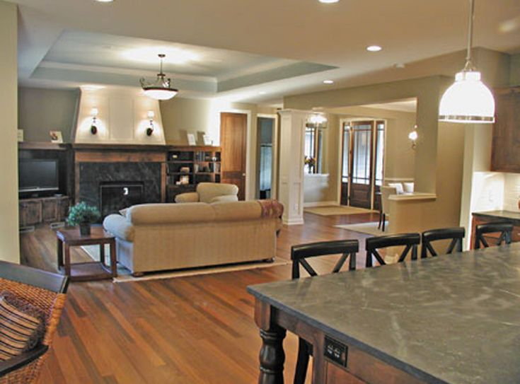 Open Floor Plan With Tray Ceiling To Designate Great Room