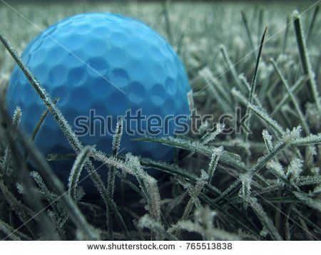 blue golf ball on ice-covered crystal grass