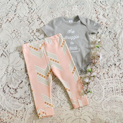 Kid's Pink Aztec Arrow Leggings. The snuggle is real when your baby is in these pink aztec leggings! Made with 100% Organic Cotton, these leggings are seriously so darling. Perfect for your little diva. Support handmade boutiques and purchase from Nora Gray! A small town Indiana boutique located in Berne, IN. We specialize in small makers across the USA.