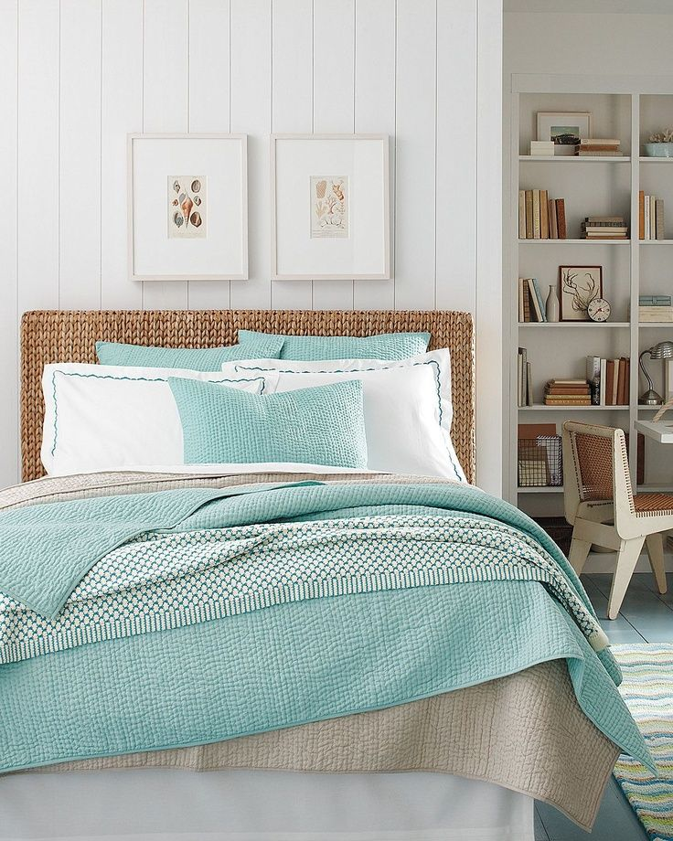 Beautiful color/pattern combinations in this room. Soft aqua, linen white and natural sisals