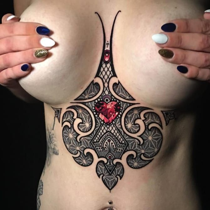 Sacred geometric underboob tattoo by Coen Mitchell. #CoenMitchell #sacredgeometric #sacredgeometry #underboob #pointillism #gem #heart