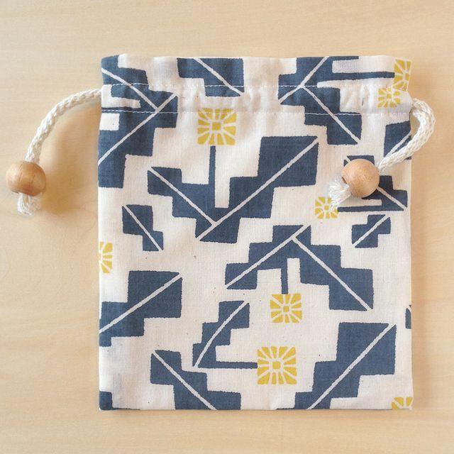 手刷り生地の巾着「タンポポ」