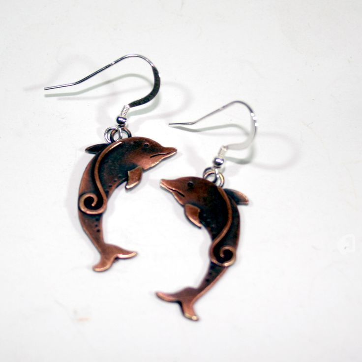 Dolphins make such fabulous shapes for jewellery. Copper jewellery is coming in as silver is so much more - £33 for copper £49 for silver version  with hoops or stud fitting. wonderful www.thewowgallery.co.uk has the lot..