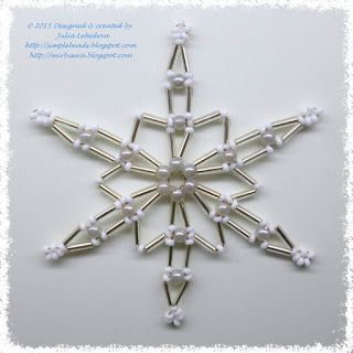 Snowflake of bugle beads, seed beads, round beads and wire. Free pattern with detailed tutorial.