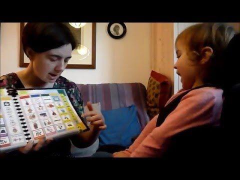 Anna (5yrs) using eye-gaze coded access to communicate using a 40pp PODD book.