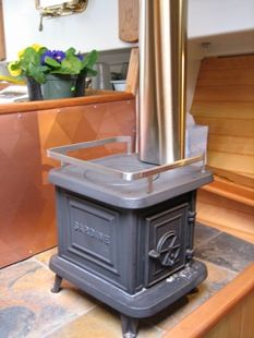 "At under 1 cubic foot, the Sardine weighs about 35 pounds, and requires a 4-inch chimney pipe. Believe it or not, this little wood (or hardwood charcoal) stove is rated as an 86%-efficient, non-catalytic ""clean burning"" stove, and carries U.S. EPA & State of Washington Emission Certifications."