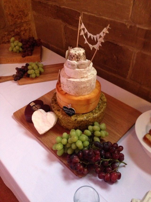 Cheese wedding cake, served with rustic bread, crackers and grapes