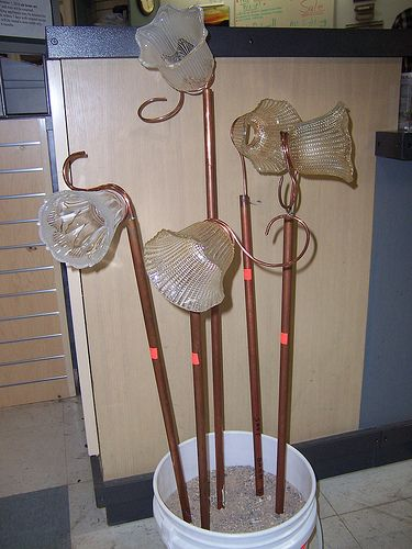Repurposed Items | ReStore Repurposed Items - Glass shades and copper pipe become garden art. I love these!