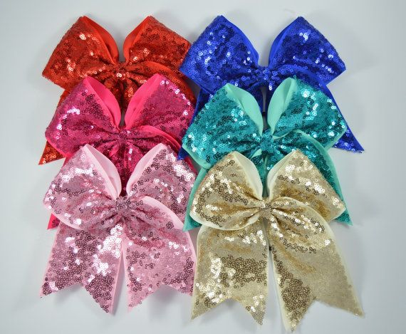 You pick one (1) giant 8 sequin cheer bow. 6 colors to choose from!   *Made of high quality grosgrain ribbon and a second layer of sequin fabric. *Tied securely and ribbon ends are heat sealed. *Made of 3 ribbon and measures 8 in length *Pony-O finish ***We CAN make large quantities for teams and events! Send us a message!***