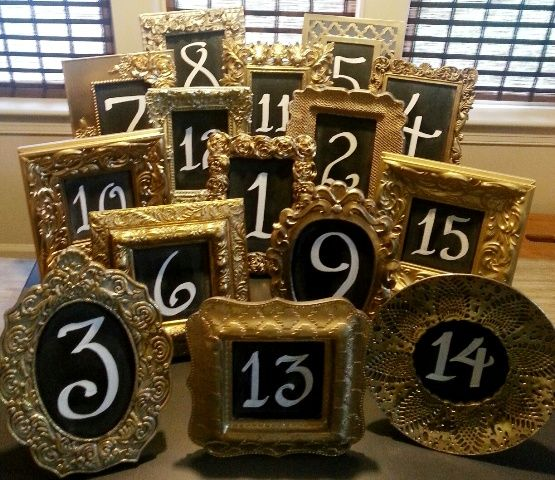 My mix & match chalkboard table numbers in gold frames.  Love these!  Calligraphy by Carrie