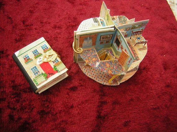 - Miniature Pop up Book Dollhouse by Jana Wichmann (approx size 2.8 x 2 cm)
