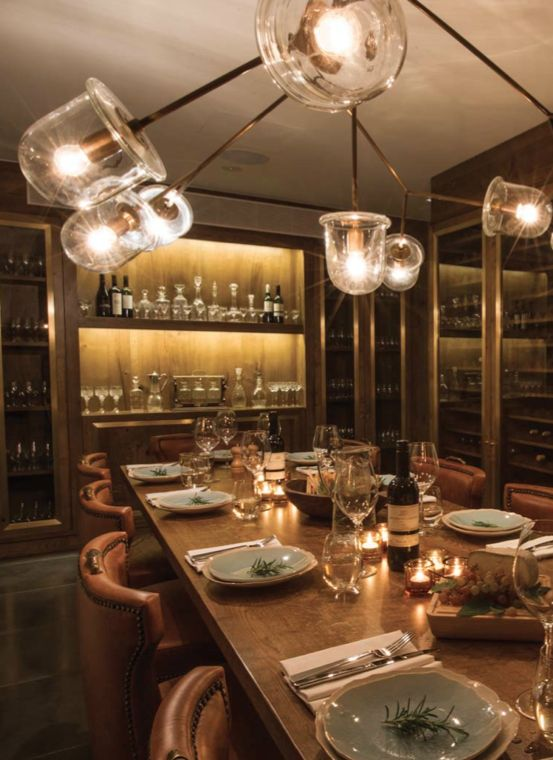 The private dining room in The Wine Room #venue of the Ampersand Hotel in #London has walls of wine, incredible leather chairs and a brass statement chandelier.