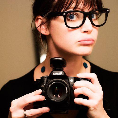 big glasses and camera.