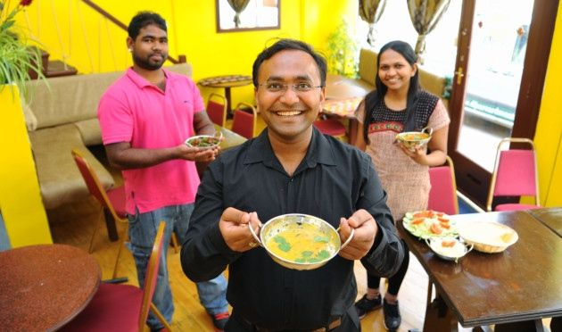 Vijay Jetani, centre, at his vegetarian Indian restaurant Namaste India in Opie Street, with his wife Urmila, and chef Naresh Kanthasamy. Picture: Denise Bradley
