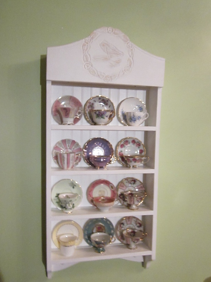tea cup shelf. collectors shelf, 12 cup Cardinal pattern. $350.00, via Etsy.