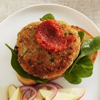 Veggie Burgers      1 ounce can cannellini beans, rinsed and drained      1 1/2 cups soft bread crumbs      1/4 cup shredded carrot      1/4 cup finely chopped onion      1 egg      2 tablespoons snipped fresh parsley      3 tablespoons olive oil      4 slices country Italian bread, toasted      1 cup packed fresh baby spinach      1/4 cup Easy Tomato Sauce