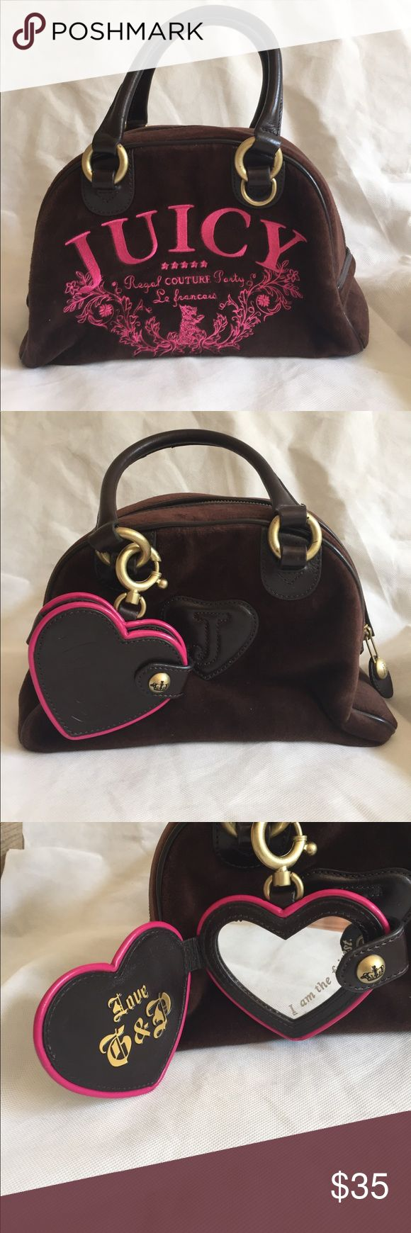 Juicy Couture Suede Handbag Handbag is in very good condition.Bottom has a few marks on it.Handle has some peeling. Juicy Couture Bags