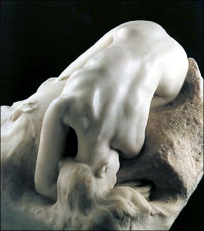 """August Rodin DANAÏD, 1885.  Instead of representing the Danaïd in the act of filling the barrel, as in conventional iconography, Rodin depicts her despair as she realizes the pointlessness and absurdity of her task. Exhausted, she rests her head """"like a huge sob"""" on her arm, while her outspread """"liquid"""" hair, to quote Rilke, merges with the water from her overturned vase."""