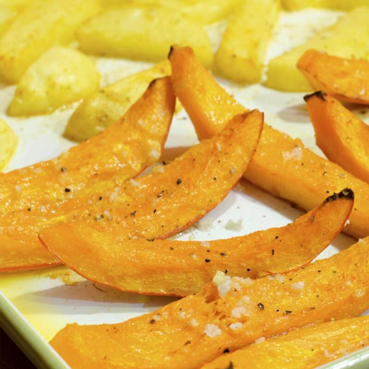 OVEN ROASTED SQUASH  This oven roasted squash is a method that can be applied to any squash, potatoes, or sweet potatoes.  Ingredients  one medium-sized squash of your choice 3 garlic cloves  2 -3 Tablespoons olive oil 1/2 teaspoon salt 1/2 teaspoon pepper 1/2 cup fresh shredded parmesan cheese  Preheat oven to 350 degrees F.  Line a baking sheet with parchment paper and brush olive oil onto the parchment paper.  Wash the squash before using.  Cut the squash in half and remove the seeds…