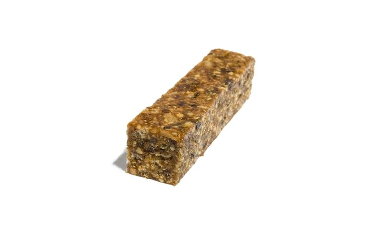A homemade energy bar with dates, figs, almonds, and brown rice cereal.