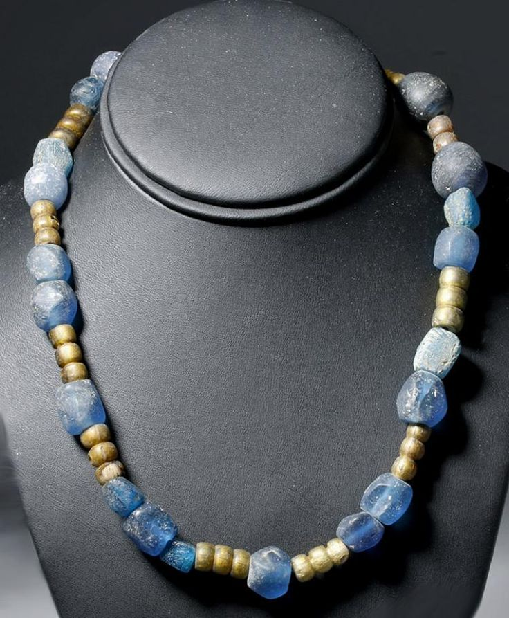 Viking Glass Bead Necklace, 8th-11th Century ADThis is made of two kinds of glass beads and was meant to be worn by a Viking woman. The smaller beads appear to be Norse-made copies of Islamic glass beads that were blown around gold; instead of using...