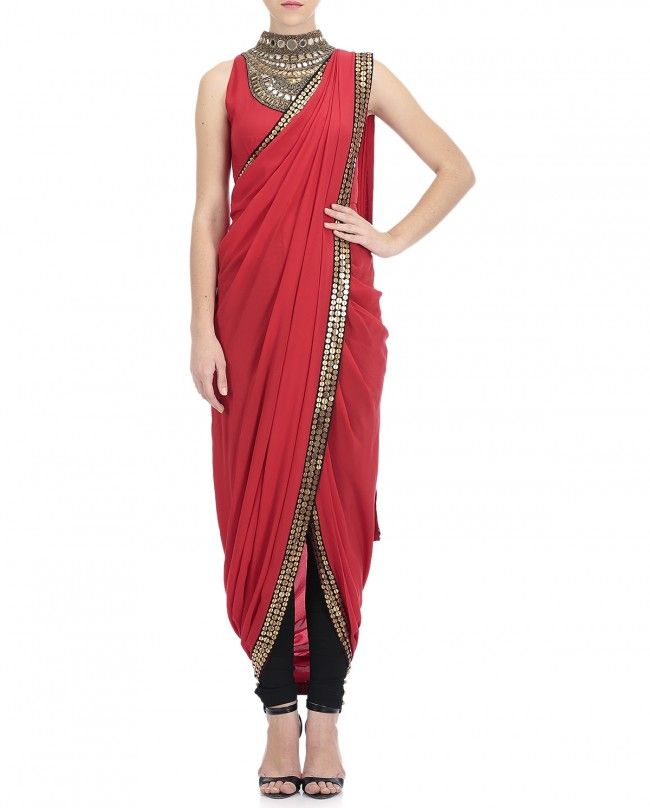 Crimson red pre drape sari adorned with coin motifs border panel across the length. Red sleeveless attached blouse with golden embroidery on neckline included. Wash Care: Dry clean Only Pants worn by the model is for styling purpose only
