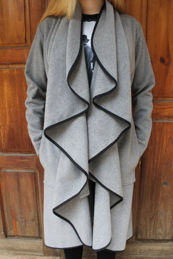 100% wool - a very warm, soft, comfortable and elegant coat! This grey coat will surely make you stand out - the beautiful waves are a definite dazzler. Lined with leather, they stay soft and fall gorgeously - always! I love to wear this coat with my high heel boots or my flat booties.