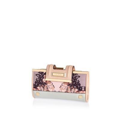 I'm shopping Pink print fold over tab purse in the River Island iPhone app.
