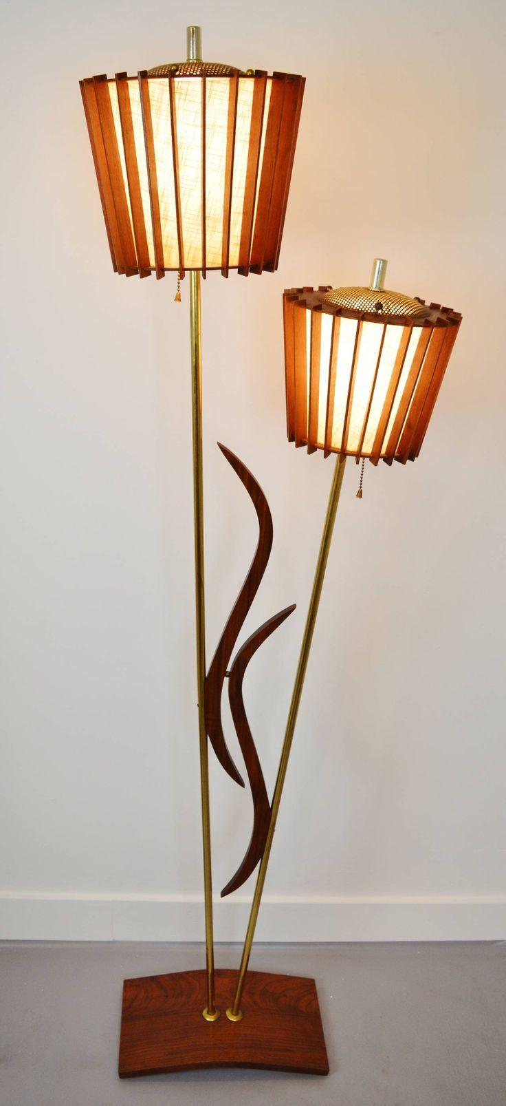 Mid Century Teak Floor Lamp, zero Tiffany lamp in a single side from the room having a modern sleek desk lamp over the room.
