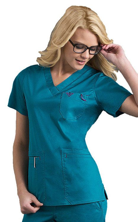 This scrub top comes with lots of bonus features, like the extra pockets and badge loop. Color featured here: #Teal with Eggplant.