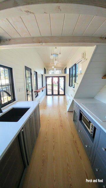 The Burrow: a beautiful, sleek tiny home with a bright and open layout. Designed and built by Perch and Nest of North Carolina.
