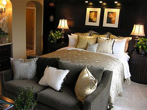 extreme makeover home edition bedroom. Luxury bedroom. Bed with couch at the end.
