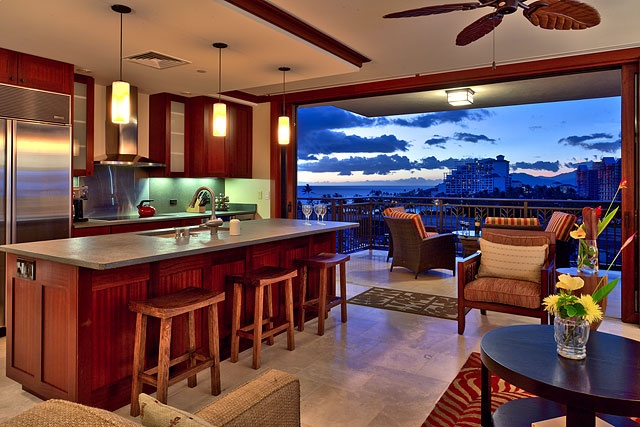 Hawaii: fully open to deck/balcony, living area directly across island, ceiling fan. Dining on other leg of ell; entrance, bathroom, closet, stairs to bedrooms in hollow of ell.
