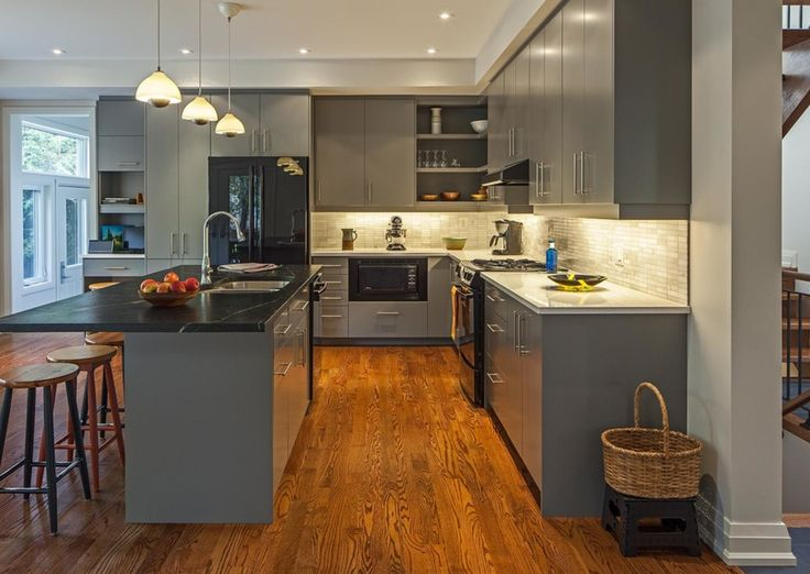While it may appear chilly as compared to its neutral counterparts, gray works well when paired with warm materials, such as wood, or a contrasting hot and bold hue, such as red, orange or yellow. Excellent for our tropical weather, a gray kitchen gives off a cool, clean and elegant vibe. #kitchen #house #interiordesign #home #decorating #decoratingtips #paint #painting #diningroom #gray