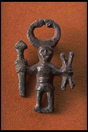 17520 Bronze figure with Horns, weapons and crossed sticks. Kungsängen, Uppland, Sweden. Iron Age
