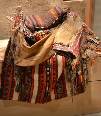 Camel saddle decorated with Saudi bedouin wooven rugs in Al Masmak Fort