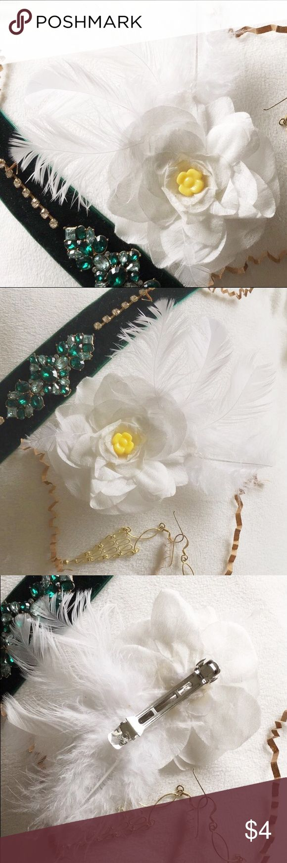Feather hair clip Homemade hair clip. There are some white feathers with a white flower on top and a yellow bead was glued in the center of the flower. This hair clip gives off a vintage vibe and would look great with a white crop top and some jean shorts. Accessories Hair Accessories