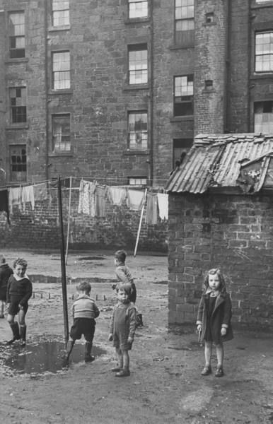 Children playing in the slums. Photograph by Mark Kauffman. Glasgow, Scotland, September 1948.