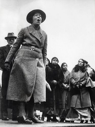 Collage her yelling into something Suffragette Sylvia Pankhurst speaking out