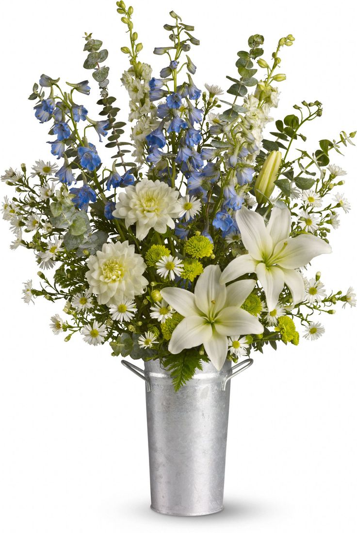 Beachside Bliss bouquet is perfect for a summer soiree or a wedding on the sand. This tin pail of summer blooms is a beautiful, beachy choice.