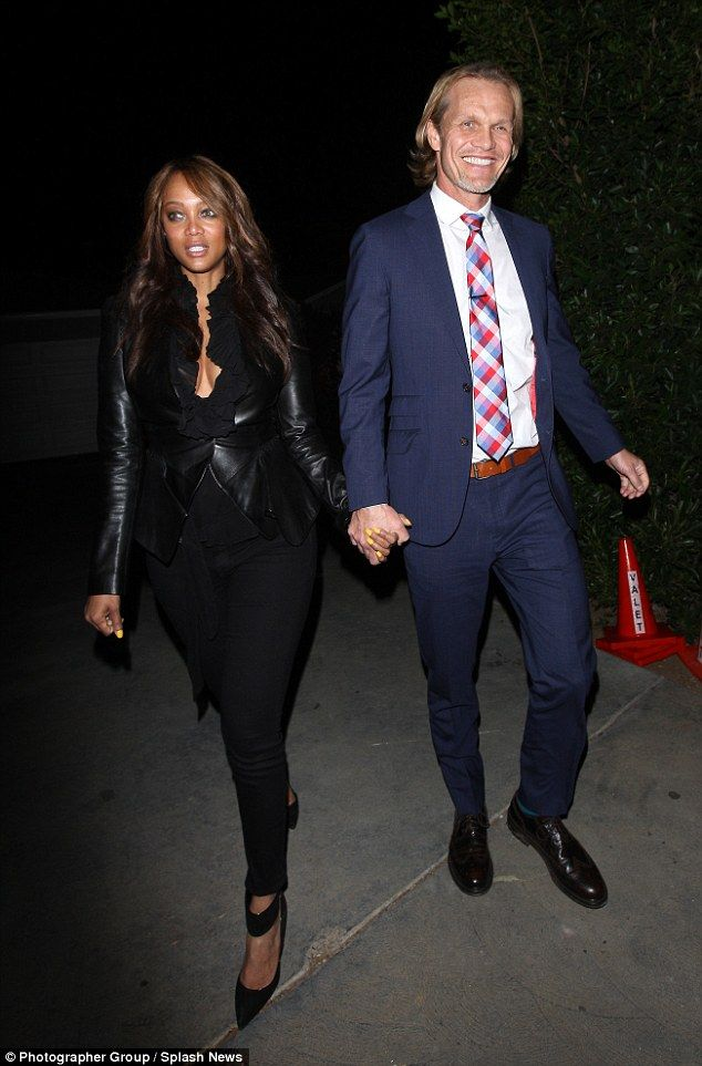 Show of support: Tyra Banks looked lovely in leather as she arrived with her smiling boyfr...