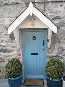 Holiday Cottage in Dolgellau, Snowdonia National Park, showing traditional black ironmongery.  See link for similar door with nickle furniture instead of black. http://www.pinterest.com/pin/524669425311332295/