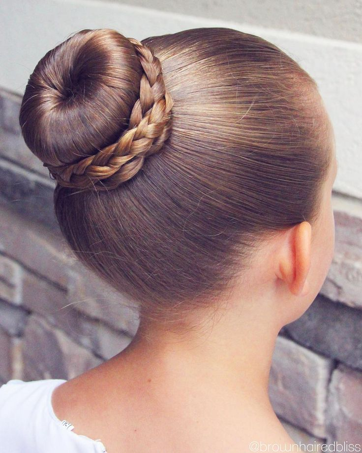 Ballet Bun with braids wrapped around.